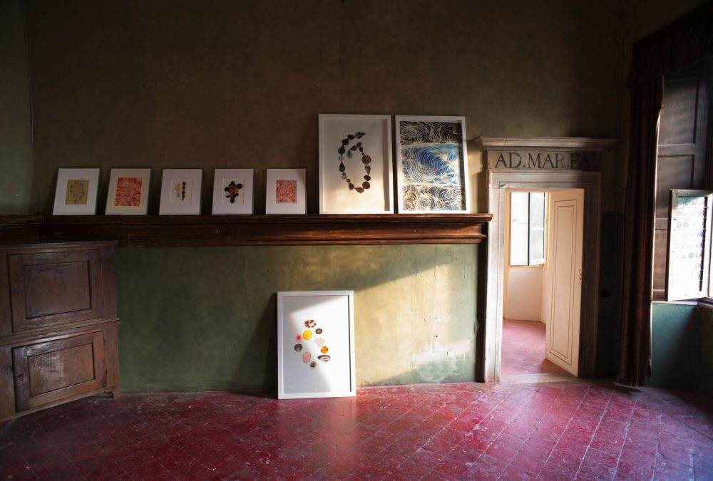 Installation view at Palazzo Barbò (Bergamo), artist Maurizio Donzelli's collages and acrylics,