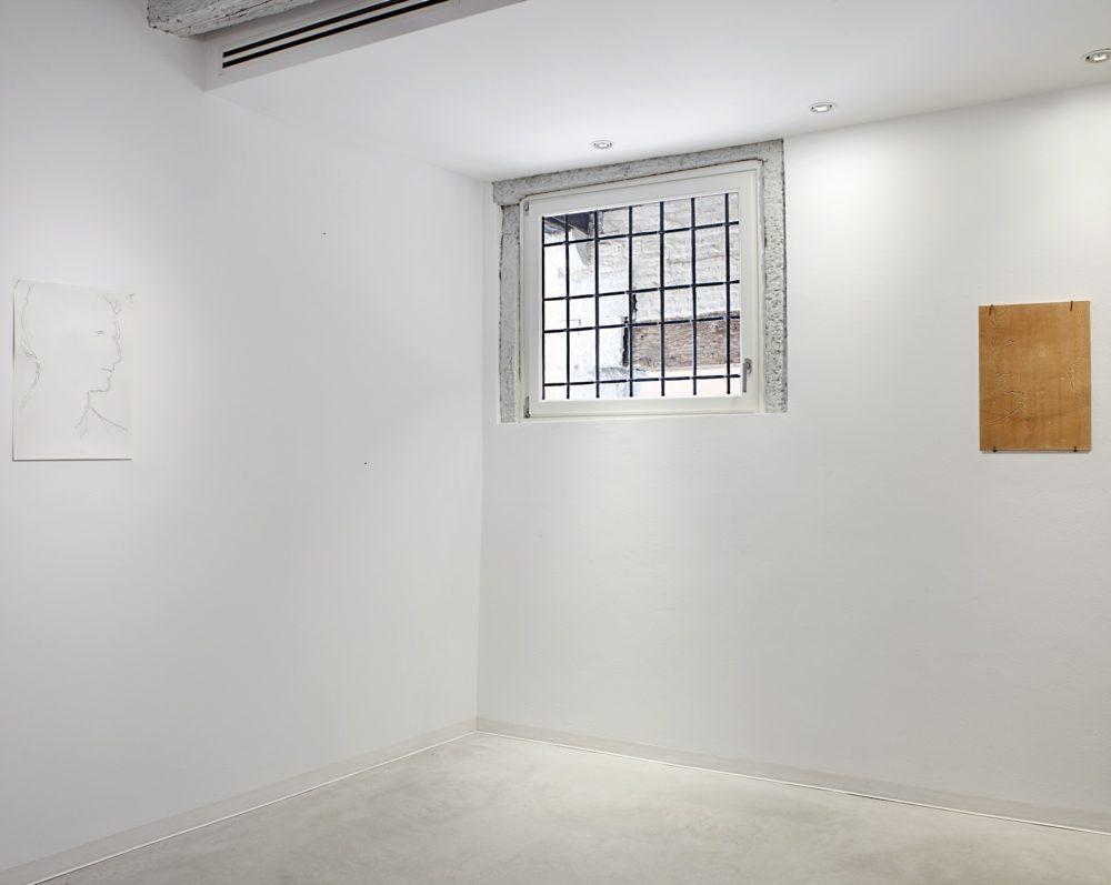 Installation view, Marignana Arte, Copertine, Stefano Arienti, Testa d'uomo (Andrea del Sarto), 2013, Perforated poster, Testa d'uomo (Andrea del Sarto), 2013, Gres refractory and drilling