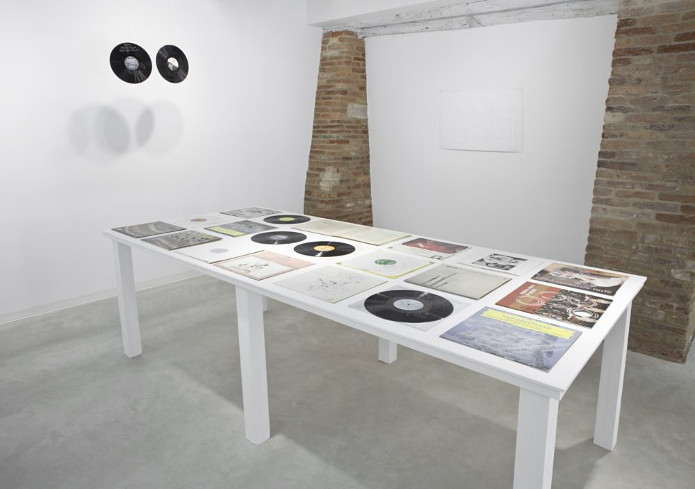 Installation view, Marignana Arte, Copertine, Stefano Arienti, Dischi, 2013, Perforated vinyl records