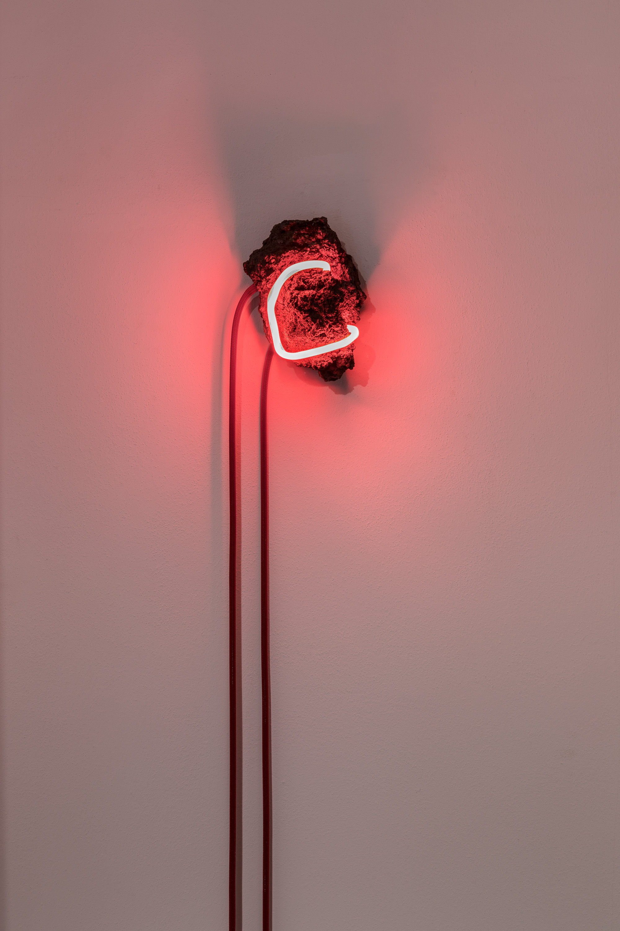 Arthur Duff, Red Vein, 2016, lava stone and red neon, variable dimensions