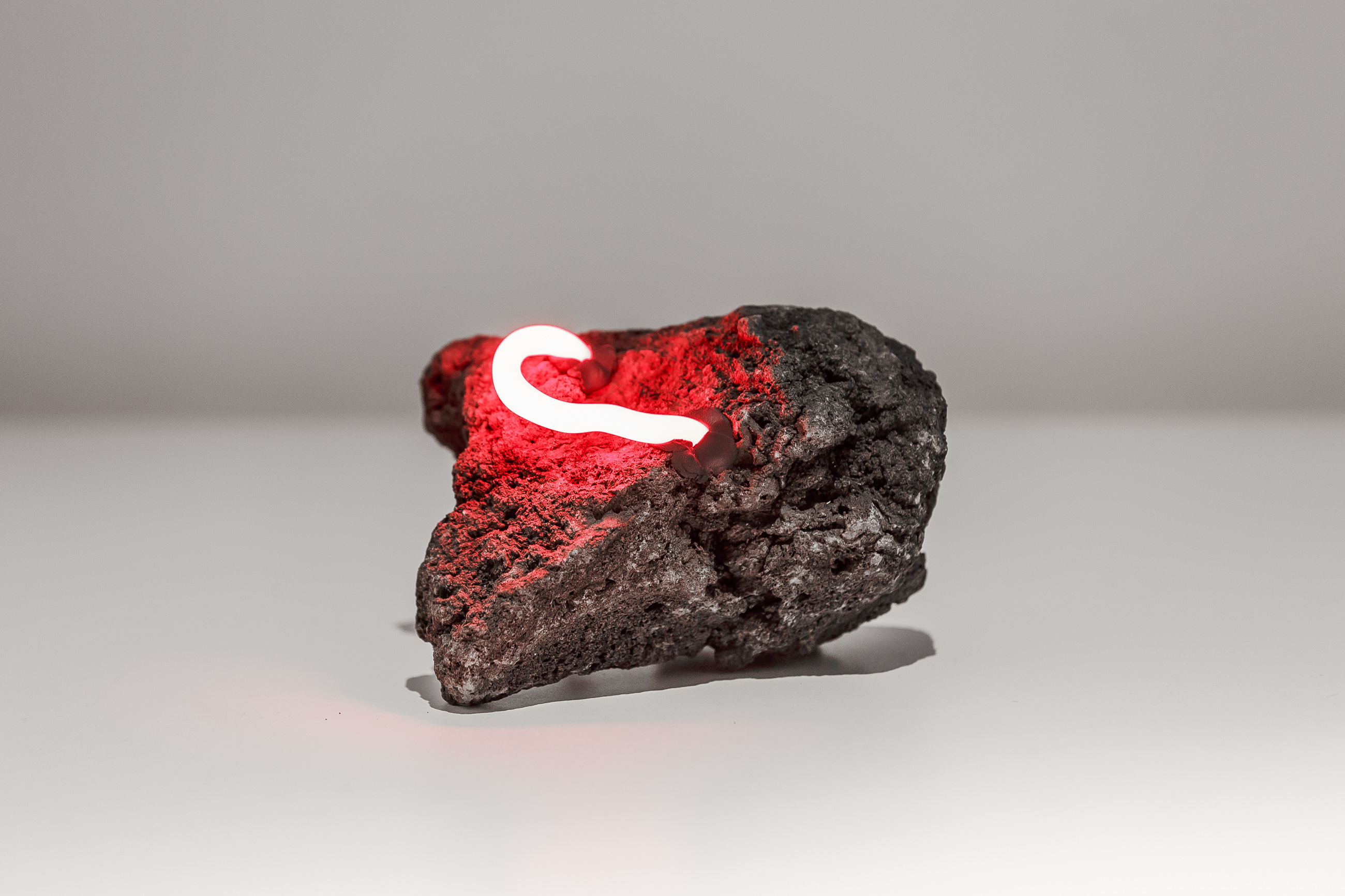 Arthur Duff, Endings, 2015, lava stone and red neon, variable measures